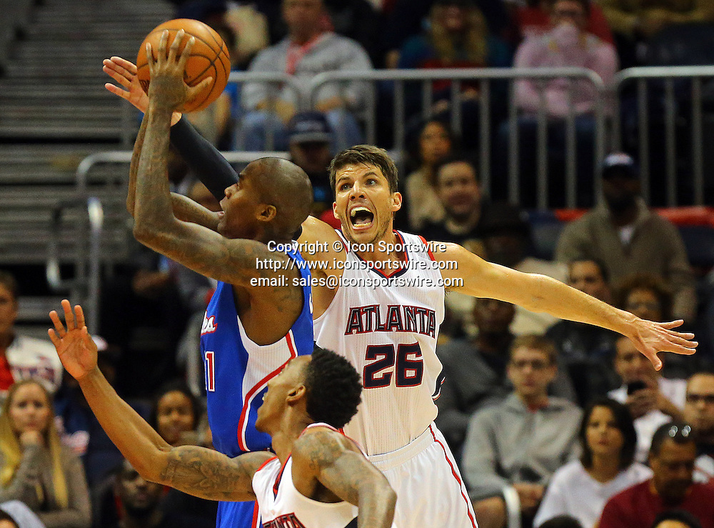 Dec. 23, 2014 - Atlanta, GA, USA - The Los Angeles Clippers' Jamal Crawford gets a shot off against the Altanta Hawks' Kyle Korver, right, during the first half at Philips Arena in Atlanta on Monday, Dec. 23, 2014