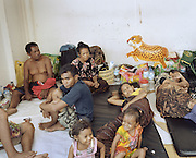 Passengers gather on the outer deck's floor of KM Bukit Siguntang that sail passing from Nunukan in Borneo to Kupang in Lesser Sunda Islands. Thanks to the limited voyage schedule, the ship often sails over its capacity. The passengers have to struggle to get a bed to rest.<br /> <br /> Indonesia&rsquo;s Pelni is the last great true passenger liners company in the world. It is the only company of its size that still serves scheduled vessels transporting people across various destination. In a far-flung archipelago nation, where many of the islands have no airport and most of its area made up of water, it is one important mean of transportation&mdash;and simply one of the best way to travel. One of Pelni's furthest regular route starts from Surabaya in East Java and ends in Papuan city of Merauke, basically the eastern end of Indonesia. The round trip voyage takes one month, passing more than two dozen ports and covering a distance of more than 8,000 kilometers.