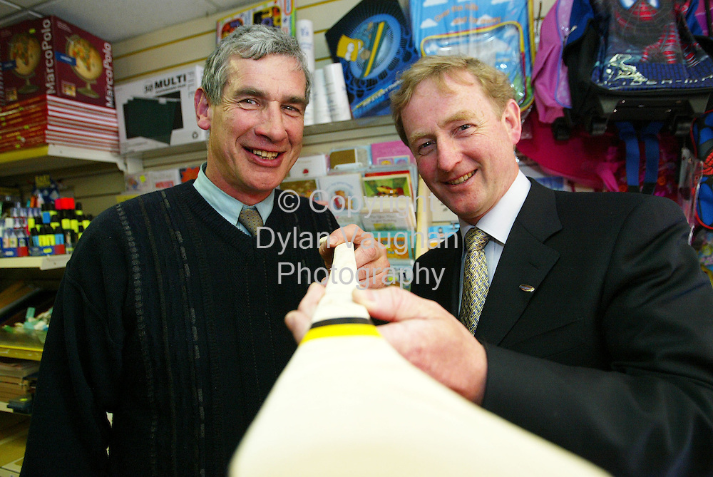8/5/2004.Enda Kenny leader of Fine Gael pictured recently during his visit to Kilkenny as part of his European and Local Election Campaign Trail .Pictured during the visit was from left Mick Crotty of Crottys Toymaster on High Street with Enda Kenny leader of Fine Gael.Picture Dylan Vaughan