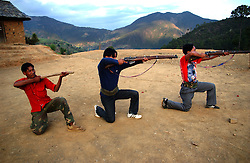 Maoist soldiers practice with old guns left by the British colonialists and a stick because there are not enough weapons for everyone  in Tila, village in  Rolpa district in Western Nepal March 14, 2005. Ami Vitale