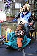 18 October 2013. Manhattan, New York. West Side Family Preschool, 63 W 92nd St. Gio and Julius in the backyard of West Side Family Preschool. 10/18/13. Photograph by Nathan Place/NYCity Photo Wire