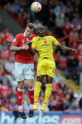 Bristol City's Aden Flint jumps up for the ball with Milton Keynes Dons' Benik Afobe - Photo mandatory by-line: Dougie Allward/JMP - Mobile: 07966 386802 - 27/09/2014 - SPORT - Football - Bristol - Ashton Gate - Bristol City v MK Dons - Sky Bet League One