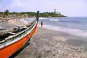 boat at crowded beach, kerala, india