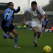 Photo Peter Spurrier.22/02/2003.Sport - Nationwide Football League Div 2.Wycombe Wanders v Wigan Athletic.Danny Senda left and Lee McCulloch