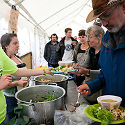 The camp was only set up over night but already the camp kitchen can feed numerous hungry people. Reclaim the Power camp is set up in a field near Balcombe. The site is squatted but so far nor the owner nor police has made any moves to stop the camp from setting up. It is organised by the environmental group No Dash for Gas and the movement is protesting against the company Cuadrilla's fracking testing near Balcombe and have come to Balcombe to len its support to the local protests against the drilling for gas.