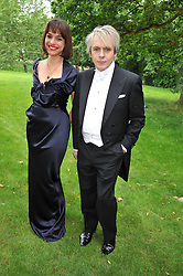 NICK RHODES and MARIE-LOUISE STOFFEL at the Raisa Gorbachev Foundation fourth annual fundraising gala dinner held at Stud House, Hampton Court, Surrey on 6th June 2009.
