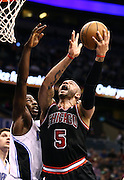 Jan 2, 2013; Orlando, FL, USA; Chicago Bulls power forward Carlos Boozer (5) attempts to score as Orlando Magic power forward Andrew Nicholson (44) defends during the first quarter at Amway Center.
