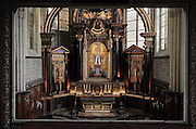 High Altar, made 1610 in Italian Renaissance style, donated by Marie de Medici, wife of Henri IV, on the birth of Louis XIII, in the Basilica of Liesse Notre Dame, built 1134 in Flamboyant Gothic style by the Chevaliers d'Eppes, then rebuilt in 1384 and enlarged in 1480 and again in the 19th century, Liesse-Notre-Dame, Laon, Picardy, France. The statue of the Black Virgin and child stands in front of a fresco of the Pentecost, and above is a bas-relief of the Assumption of the Virgin. Pilgrims flock here to worship the Black Virgin, based on Ismeria, the Soudanese daughter of the sultan of Cairo El-Afdhal, who saved the lives of French knights during the Crusades, converted to christianity and married Robert d'Eppes, son of Guillaume II of France. Picture by Manuel Cohen