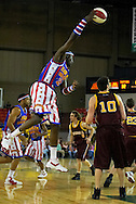 "05 May 2006: Kevin ""Special K"" Daley throws a circus pass during the Harlem Globetrotters game vs the New York Nationals at the Sulivan Arena in Anchorage Alaska during their 80th Anniversary World Tour."