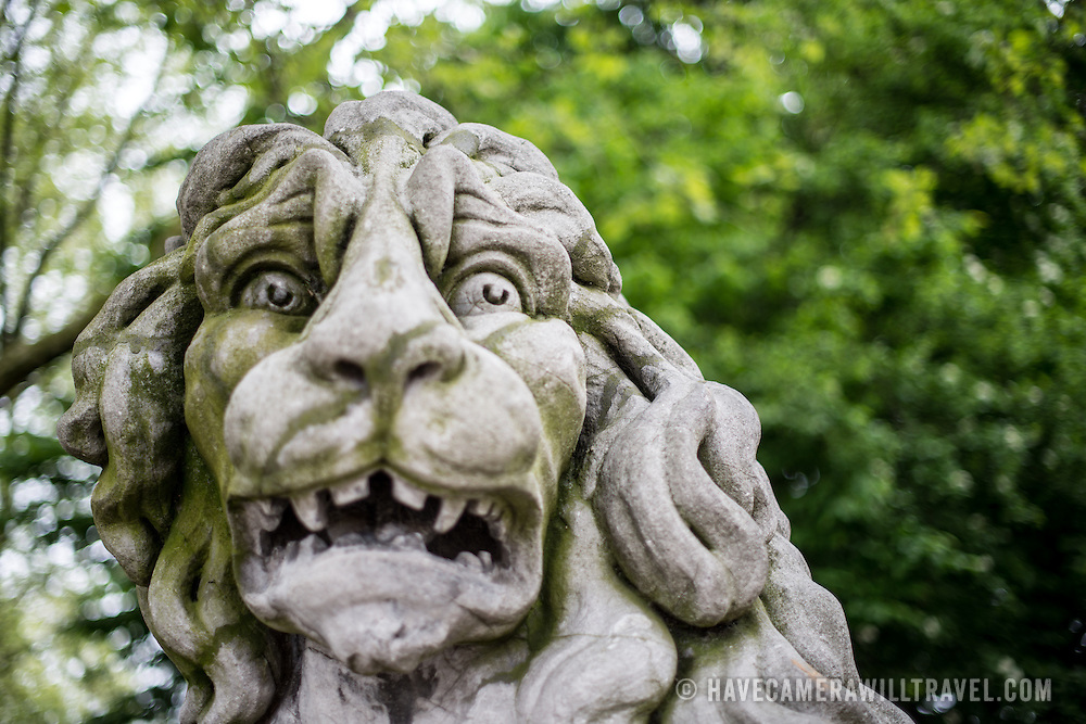 A statue of a lion sits in Brussels Park opposite the Royal Palace of Brussels on Coudenberg Hill in the center of the city.