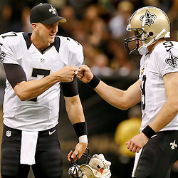 Sep 21, 2014; New Orleans, LA, USA; New Orleans Saints quarterback Drew Brees (9) celebrates with quarterback Luke McCown (7) during the second half of a game at Mercedes-Benz Superdome. The Saints defeated the Vikings 20-9. Mandatory Credit: Derick E. Hingle-USA TODAY Sports