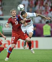 FUSSBALL  EUROPAMEISTERSCHAFT 2012   VORRUNDE Tschechien - Polen               16.06.2012 Tomas Huebschman (li, Tschechische Republik) gegen Marcin Wasilewski (re, Polen)