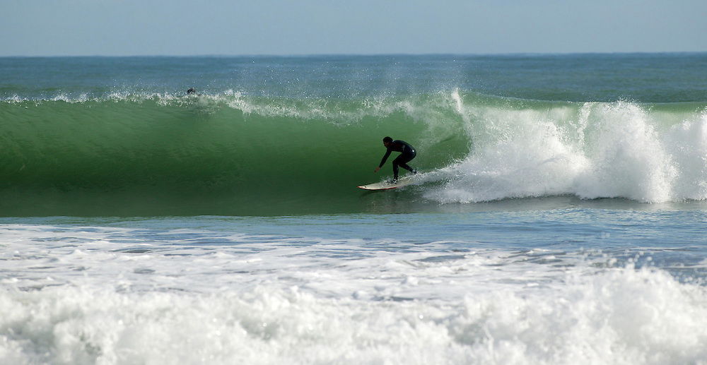 A surfing pipeline at the Fitzroy surf beach, New Plymouth, New Zealand, July 19, 2004. Credit:SNPA / Rob Tucker
