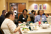 School of Business faculty Nicole Antoinette Smith and Brandon Wright converse at the New Multicultural Faculty and Staff Luncehon.