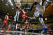 Sumter Central's Kedrick Turnipseed tries to penetrate and shoot amidst a swarm of Clarke County defenders during the Southwest Regional at the Dunn-Oliver Acadome in Montgomery, Feb. 19, 2019.  [Staff Photo/Gary Cosby Jr.]