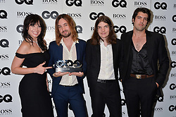 DAISY LOWE with Kevin Parker, Dominic Simper and Cam Avery of Tame Impala at the GQ Men of The Year Awards 2016 in association with Hugo Boss held at Tate Modern, London on 6th September 2016.