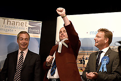 UKIP leader Nigel Farage (left) and Conservative candidate Craig MacKinlay (right) look on as Al Murray, The Pub Landlord celebrtaes gaining 318 votes in the 2015 South Thanet election count held in the Winter Gardens, Margate. Photograph by Mary Turner
