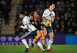 Hull City's Josh Tymon (centre) pushes through Manchester United's Jesse Lingard (left) and Zlatan Ibrahimovic (right)