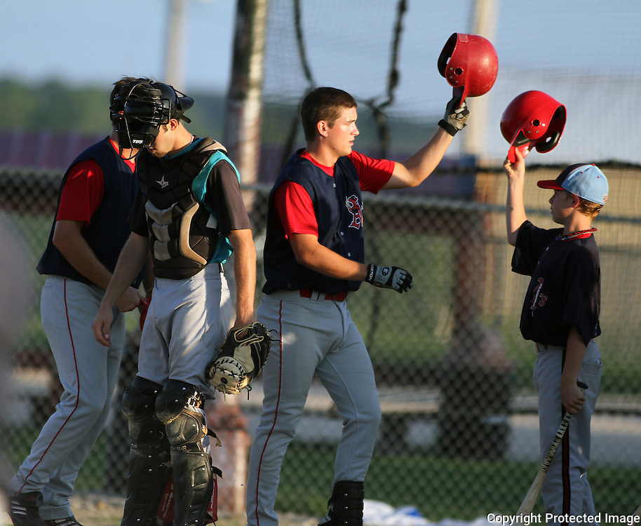 To celebrate his home run in the first inning, Grant Clyde taps batting helmets with the team batboy after rounding the bases.  photo by David Peterson <br /> <br /> get batboy's name