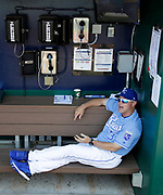 Kansas City Royals' manager Ned Yost relaxes in the dugout before his team's baseball game against the Chicago White Sox at Kauffman Stadium in Kansas City, Mo., Sunday, July 23, 2017. (AP Photo/Colin E. Braley)