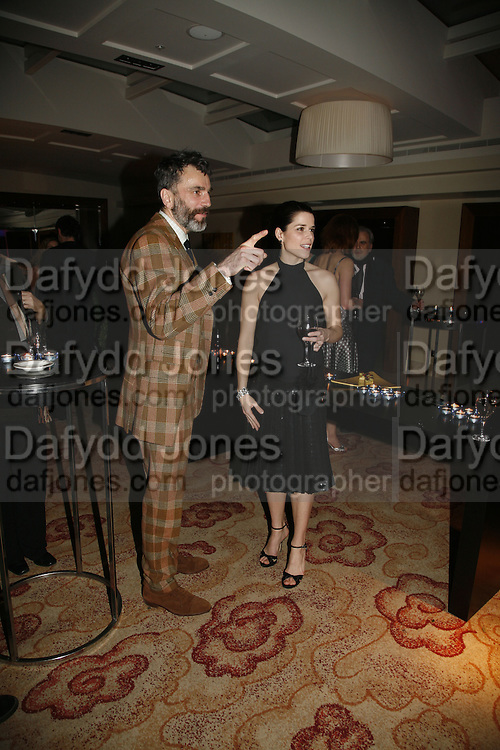 DANIEL DAY-LEWIS AND NEVE CAMPBELL. The party for 'Resurrection Blues' following the opening at the Old Vic. The Riverbank Park Plaza Hotel, London.3 March 2006. ONE TIME USE ONLY - DO NOT ARCHIVE  © Copyright Photograph by Dafydd Jones 66 Stockwell Park Rd. London SW9 0DA Tel 020 7733 0108 www.dafjones.com