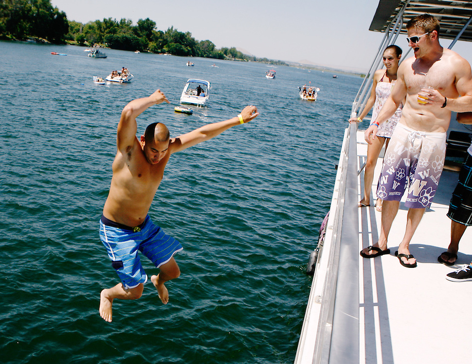 Lamont Cloy of Pasco jumps off a 59-foot house boat on Saturday during the Lamb Weston Columbia Cup. Brothers Jesse and Jerry Medrano of Kennewick co-own Versatile Media Group and rented the boat for their family, friends and employees for boat race weekend. Jesse says they may make the party boat an annual tradition after attending Water Follies on land in both Pasco and Kennewick throughout the years.