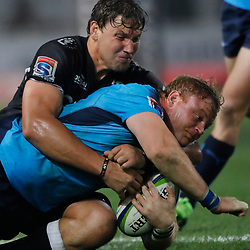 Etienne Oosthuizen of the Cell C Sharks tackling Adriaan Strauss (captain) of the Vodacom Bulls during the Vodacom Super Rugby match between the Cell C Sharks and the Vodacom Bulls at Growthpoint Kings Park in Durban, South Africa. 30th June 2017(Photo by AL NICOLL -Steve Haag Sports)<br /> <br /> images for social media must have consent and Credit Steve Haag