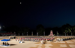 © Licensed to London News Pictures. LONDON, UK  09/06/11. As the second night of Beating the Retreat draws to a close, the Massed Bands of the Brigade of Guards, the Bands of the Household Cavalry and the US Army Europe Band and Chorus all play in formation beneath a clear sky. On two successive evenings each year in June a pageant of military music, precision drill and colour takes place on Horse Guards Parade in the heart of London when the Massed Bands of the Household Division carry out the Ceremony of Beating Retreat. 300 musicians, drummers and pipers perform this age-old ceremony. The Retreat has origins in the early days of chivalry when beating or sounding retreat pulled a halt to the days fighting. Please see special instructions. Photo credit should read Matt Cetti Roberts/LNP. Please see special instructions for usage rates. Photo credit should read Matt Cetti-Roberts/LNP
