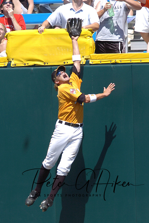 Tennessee right fielder Eli Iorg goes up high against the wall, but can't pull the ball back in against the Florida Gators.  Florida defeated Tennessee in the first round of the College World Series 6-4 at Rosenblatt Stadium in Omaha, Nebraska on June 17, 2005.