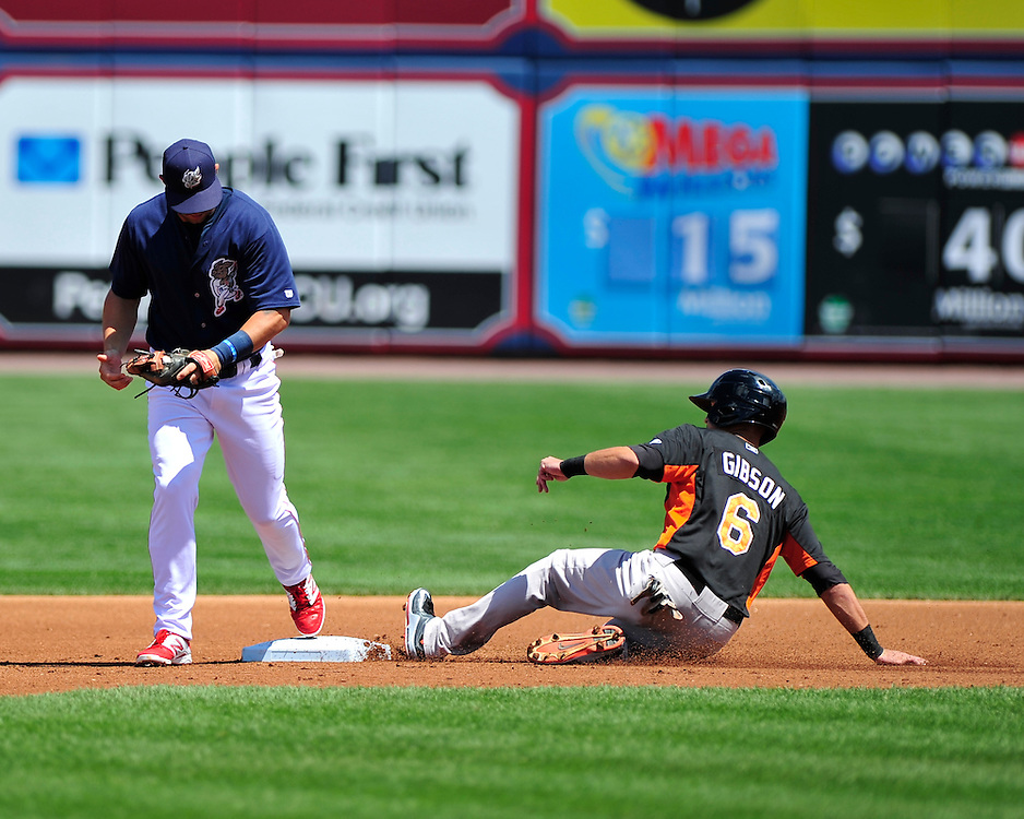 Tyler Henson tags out the Tides Derrik Gibson at second. Philadelphia Phillies 2nd baseman Chase Utley rehabs with the Lehigh Valley IronPigs in a game against the Norfolk Tides August 2nd, 2015, at Coca-Cola Park in Allentown.