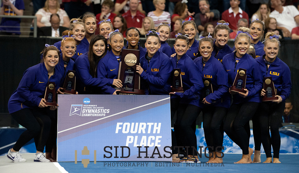 21 APRIL 2018 -- ST. LOUIS -- LSU gymnasts pose with the Fourth Place trophy after the 2018 NCAA Women's Gymnastics Championship Super Six at Chaifetz Arena in St. Louis Saturday, April 21, 2018. The Tigers finished fourth in the nation during the meet.<br /> Photo &copy; copyright 2018 Sid Hastings.