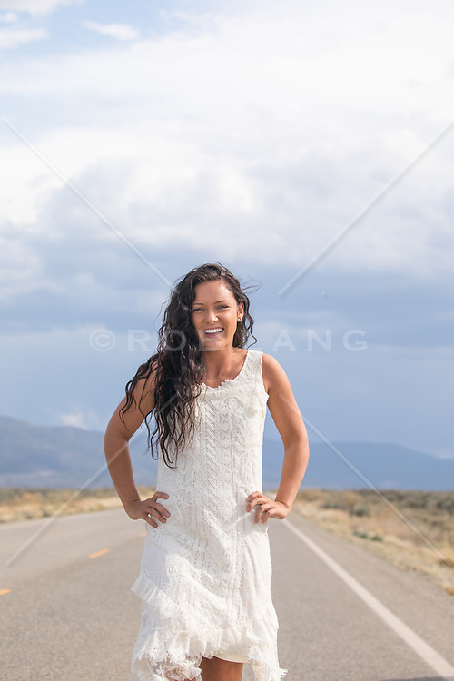 girl outdoors smiling and laughing on a road