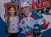 KELOWNA, CANADA - DECEMBER 30:  Boston Pizza Winner with Kole Lind #16 of the Kelowna Rockets at the Kelowna Rockets game on December 30, 2017 at Prospera Place in Kelowna, British Columbia, Canada.  (Photo By Cindy Rogers/Nyasa Photography,  *** Local Caption ***