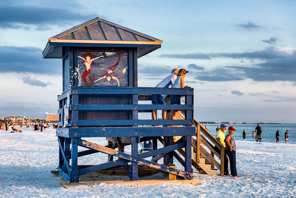 Tourists enjoy sunset view at Siesta Key Beach, Florida, USA.