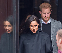 © Licensed to London News Pictures. 01/02/2019. Bristol, UK. The Duke and Duchess of Sussex, HARRY and MEGHAN leave The Old Vic Theatre in King Street with snow falling. The Old Vic Theatre was the first stop on a tour of Bristol today. Built in 1766 as a place where the people of Bristol could come together, Bristol Old Vic is the oldest continuously working theatre in the English speaking world. The Duke and Duchess are to tour the recently renovated facility, finding out more about the theatre's unique history and links to the local community. Their Royal Highnesses will also drop in on a workshop attended by local school children which is part of Bristol Old Vic's outreach programme. The final visit of the day will be to Empire Fighting Chance, which aims to fight the impact of deprivation on young people's lives through boxing. The charity supports children aged 8 to 21 who are failing at school and in danger of drifting into a life of unemployment or even crime, and helps them turn their lives around. Empire Fighting Chance works with around 250-300 children per week and runs programmes which help instil discipline, self control, and respect, whilst building self-confidence, life skills, and improving both physical and mental health and fitness. During their visit Their Royal Highnesses will have the opportunity to meet with young people using the boxing gym, speak to coaches about the positive impact Empire Fighting Chance is having on young people in Bristol and watch a couple of training sessions attended by primary and secondary school pupils. Photo credit: Simon Chapman/LNP