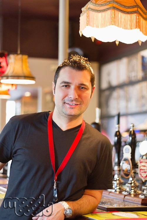 Portrait of smiling pub manager