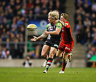 Picture by Andrew Tobin/Focus Images Ltd. 07710 761829. .27/12/11. Matt Hopper (13) of Harlequins offloads as he is challenged by David Strettle (14) of Saracens (R) during the Aviva Premiership match between Harlequins and Saracens at Twickenham Stadium, London.