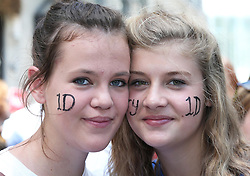 One Direction fans Mollie Brown and Emily Barnet  queueing in Leicester Square in London for the world premiere of the band's film One Direction: This Is Us,Tuesday, 20th August 2013. Picture by Stephen Lock / i-Images