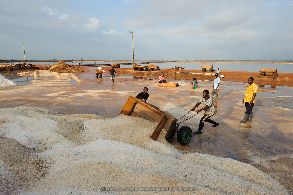 Salt is unloaded in huge heaps before being loaded into buyers' trucks.