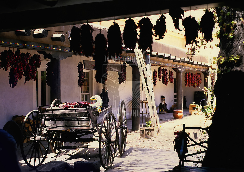 Santa Fe New Mexico. Side street with wagon and hanging chili peppers