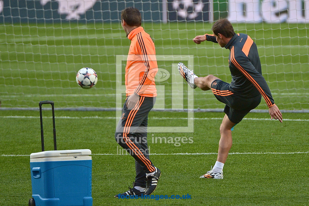 Gareth Bale of Real Madrid has shooting practice on his own away from his team mates pictured during Real Madrid training at Est&aacute;dio da Luz, Lisbon<br /> Picture by Ian Wadkins/Focus Images Ltd +44 7877 568959<br /> 23/05/2014