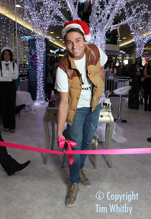CROYDON, ENGLAND - DECEMBER 03:  Joey Essex attends the launch of the grown-up Grotto in Centrale Shopping Centre on December 3, 2011 in Croydon, England.  Shoppers who spend £20 in Centrale get a free treatment in the grotto which is open until 23 December 2011.  (Photo by Tim Whitby/Getty Images)