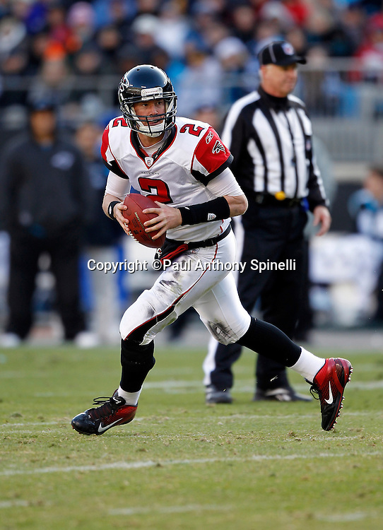 Atlanta Falcons quarterback Matt Ryan (2) scrambles while looking to pass during the NFL week 14 football game against the Carolina Panthers on Sunday, December 11, 2011 in Charlotte, North Carolina. The Falcons won the game 31-23. ©Paul Anthony Spinelli
