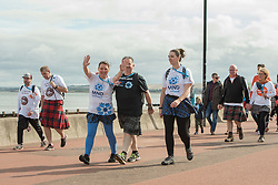 The Edinburgh Kiltwalk passed along Portobello Prom this lunchtime. Amongst the walkers, raising funds for a wide range of charities, were Portobello's four councillors, walking together in their fundraising efforts for the Thistle Foundation.  Calum Laidlaw started the 24-mile Mighty Stride in Holyrood Park while the other three councillors - Maureen Child, Mary Campbell and Kate Campbell - started the 15.5-mile Big Stroll in Musselburgh.<br /> © Jon Davey/ EEm
