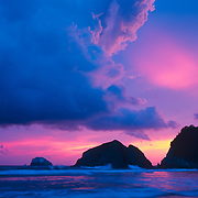 Sunset over ocean with purple clouds.Zipolite. Oaxaca, Mexico.