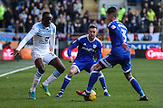 Craig Noone of Cardiff City looks on as Albert Adomah of Aston Villa attempts to tackle Joe Bennett of Cardiff City during the EFL Sky Bet Championship match between Cardiff City and Aston Villa at the Cardiff City Stadium, Cardiff, Wales on 2 January 2017. Photo by Andrew Lewis.