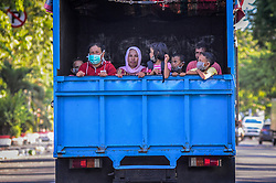 October 3, 2018 - Palu, Central Sulawesi, Indonesia - Refugees seen being loaded onto a truck which will take them to safer area..A deadly earthquake measuring 7.7 magnitude and the tsunami wave caused by it has destroyed the city of Palu and much of the area in Central Sulawesi. According to the officials, death toll from devastating quake and tsunami rises to 1,347, around 800 people in hospitals are seriously injured and some 62,000 people have been displaced in 24 camps around the region. (Credit Image: © Hariandi Hafid/SOPA Images via ZUMA Wire)