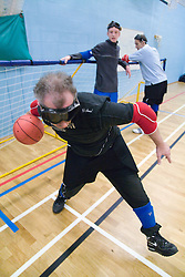 Team Player  throwing the ball during a Goalball training; a threeaside game developed for the visually impaired and played on a volleyball court, A specially adapted ball containing an internal bell is used,