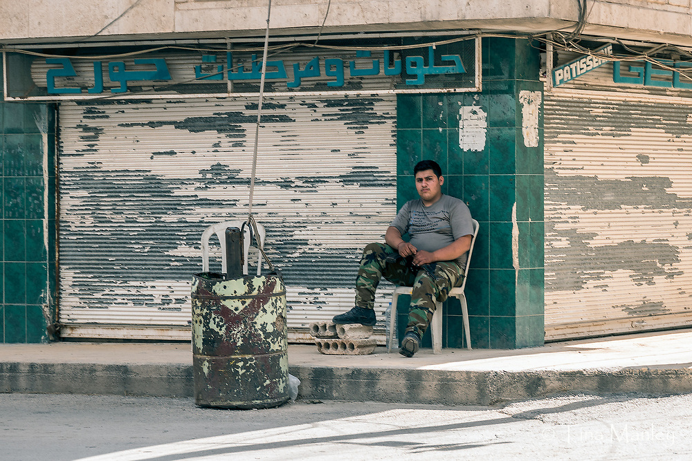 Civil guard keeps the streets safe in Kamishli, Syria.