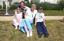 "The EARL & COUNTESS OF MARCH with two of their children LORD WILLIAM GORDON-LENNOX and LADY ELOISE GORDON-LENNOX at a luncheon hosted by Cartier at the 2005 Goodwood Festival of Speed on 26th June 2005.  Cartier sponsored the ""Style Et Luxe' for vintage cars on the final day of this annual event at Goodwood House, West Sussex. <br />
